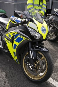 front shot of a race replica sports bike with police markings.