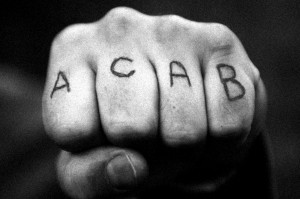 A fist with ACAB tattooed on the knuckles