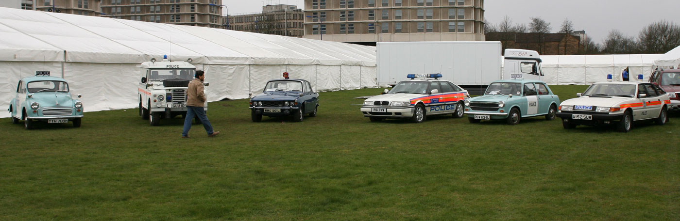 Morris 1000, Land Rover, Rover P6 3500, Rover 800, and Rover SD1 classic police cars at a show