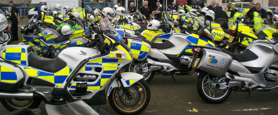 Lots of police motorcycles parked up, mostly BMW's, with a mk1 Honda Pan European in the foreground.