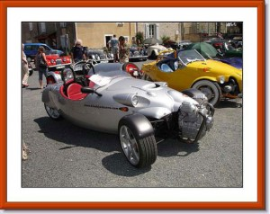 Both cars parked on gravel at a Morgan owners meet.