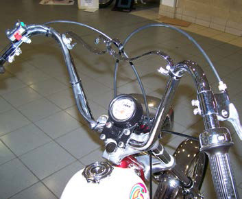 Close up of the ape hanger handlebars on the FanticMotor chopper.