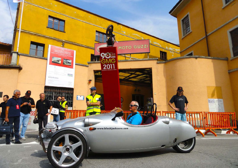 The Guzzi engined car driven by the owner, in front of the Moto Guzzi factory on Moto Guzzi's 90th anniversary.