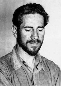A black and white head and shoulders portraint photograph of a bearded Ed Ricketts in his '30s.