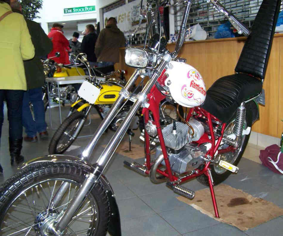 Wonderful Fantic moped Chopper, parked up with other mopeds at a show.