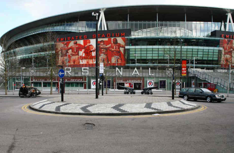The motorcycle hearse parked on the roundabout in front of the Arsenal Emirates Stadium.