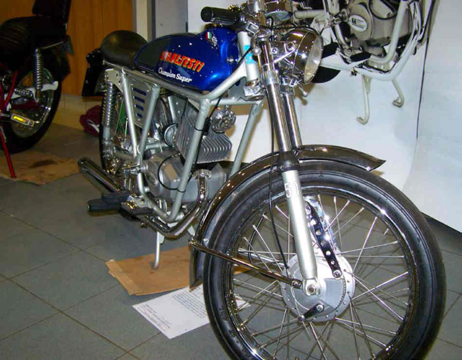Front view of an immaculate Gitane-Testi Champion Super moped, featuring ace bars and a mega price tag when new.