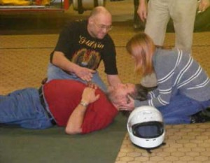 A practise first aid session, with a volonteer being taught to the basics