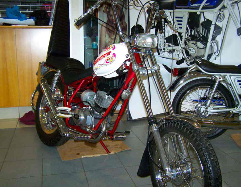 Front view of the FanticMotor chopper moped, massive ape hangers, high rise exhaust, and 50cc.