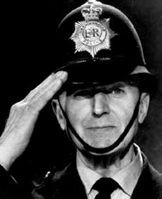 Head and shoulders portrait of Dixon of Dock Green saluting.
