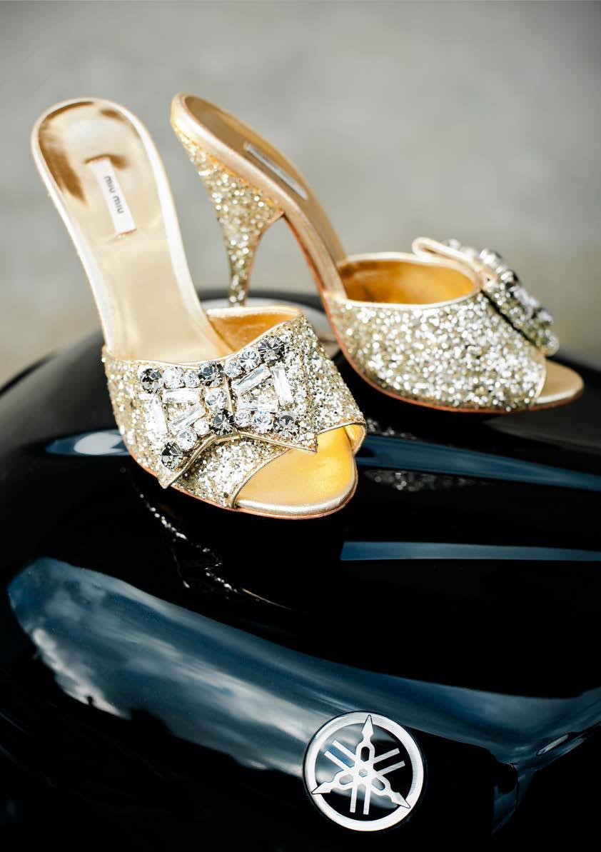 Sparky ladies high heeled shoes on a Yamaha tank