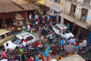 Looking down on a Kahtmandu traffic jam, cars and bikes