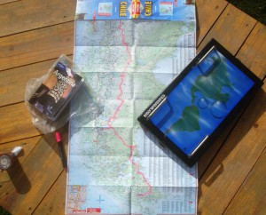Looking down on a map and other navigational equipment on a table