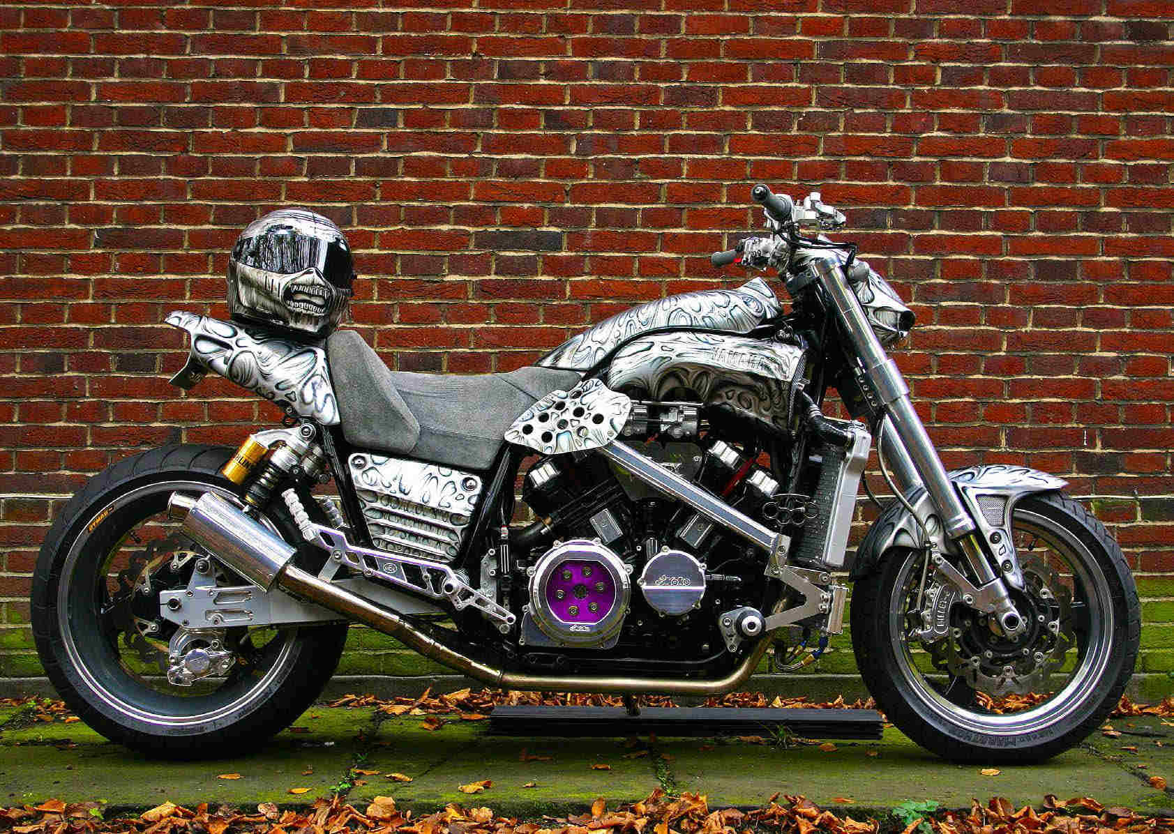Iron Maiden's low rider motorcycle, with helmet on saddle, customised to suit their mascot Eddie the Head.