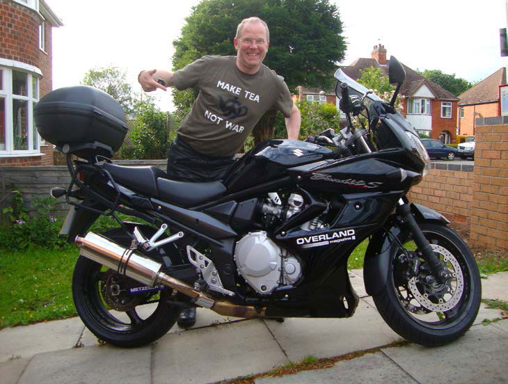 Paddy standing next to his Yamaha