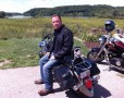 Dave sitting on his Harley in the sun